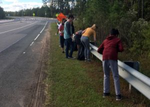 Leo club members picking up trash on McCrimmon Parkway