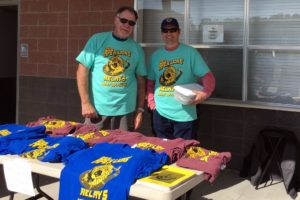 Lion Carl and Lion Rich selling shirts at the 2018 Relays