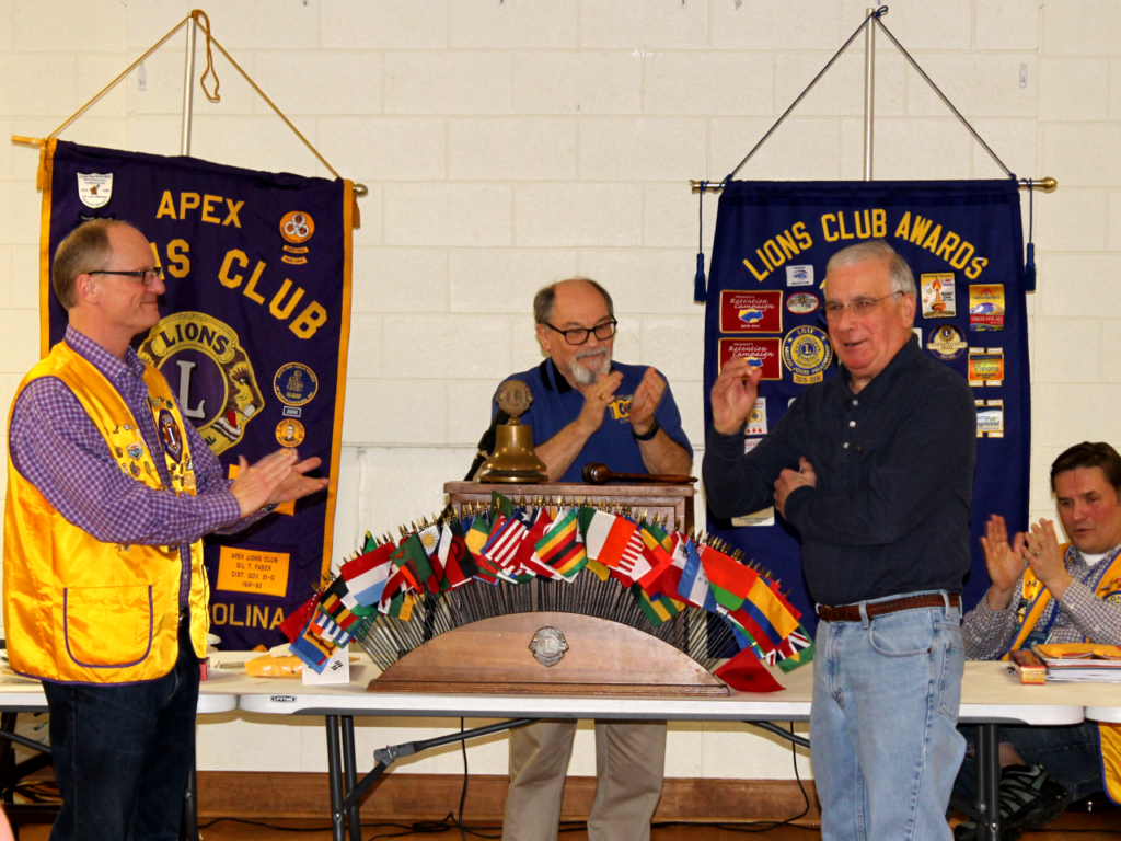 Lion John Lynde and PDG Gene English applaud new member Lion Tony Formichelli